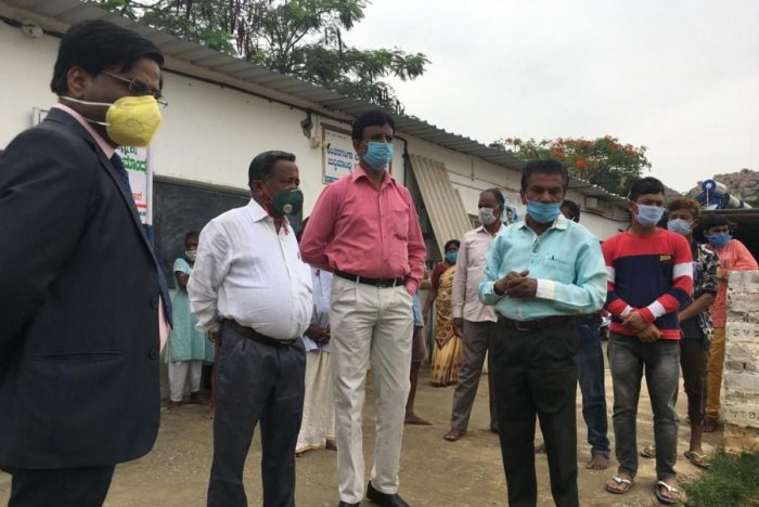 District Legal Services Authority member secretary C H Gangadhar inspects situation at Antaragange residential school for mentally challenged children where construction workers and others have been rehabilitated.