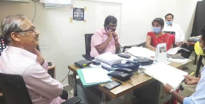 Officials take part in a phone-in programme conducted by the district administration in Kodagu.