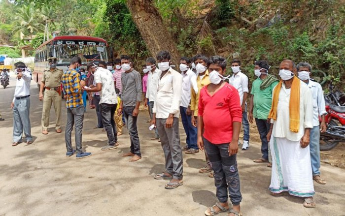 Labourers waiting for their turn to leave for their native in Sringeri.