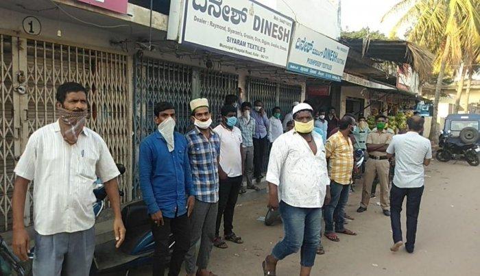 Residents curiously watch tashildar Shobitha and police conducting inspection at at Bha-Ki Masjid in Kolar on Thusday.
