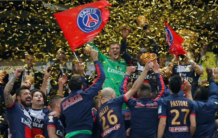 Paris St Germain's players celebrate with their trophy after defeating Olympique Lyonnais 2-1 in the French League Cup final at the Stade de France. Credit: Reuters File Photo