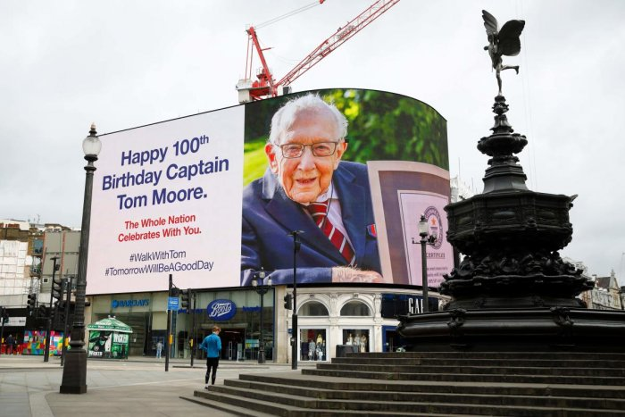 A birthday message for Captain Tom Moore is displayed on the advertising boards in Piccadilly Circus in London on April 30, 2020 as the country celebrates his 100th birthday. Credit: AFP Photo