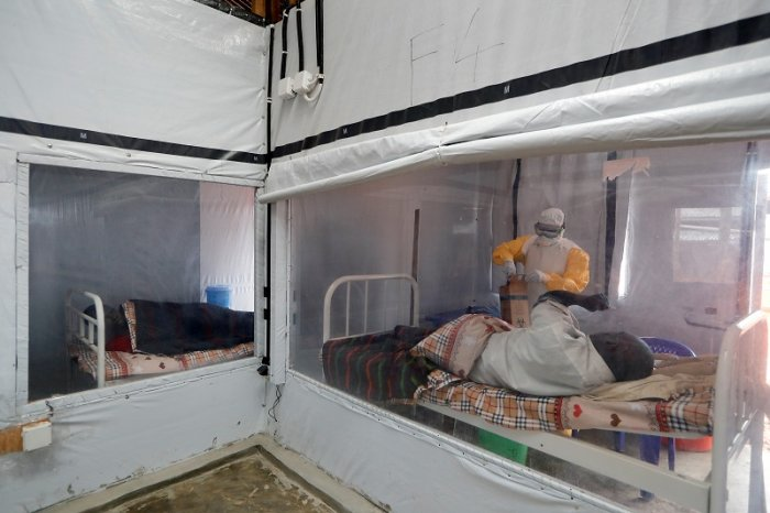 Moise Vaghemi, 33, a father of two children and an Ebola survivor who works as a nurse, tends to a patient who is suspected to be suffering from Ebola, inside the Biosecure Emergency Care Unit (CUBE) at an Ebola treatment centre (ETC) in Katwa, near Butembo, in the Democratic Republic of Congo. (Reuters Photo)