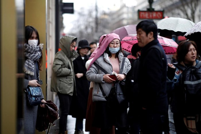 Another 102,000 people were under medical observation with possible symptoms of the respiratory ailment. (Reuters photo)