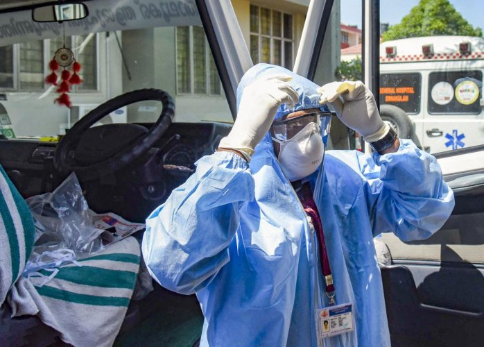An ambulance driver, wearing protective suits, prepares to exit the Special Isolation Ward with novel coronavirus patients at Kochi Medical college, in Kerala, Tuesday, Feb. 4, 2020. Credit: PTI Photo