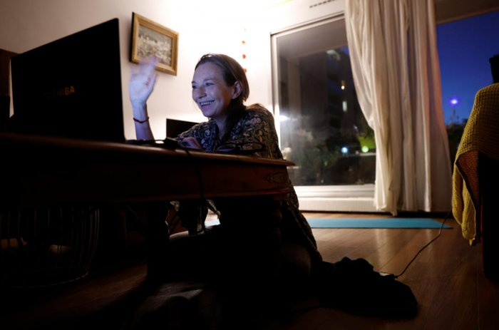 French yoga teacher Nadege Lanvin does a live broadcast of her yoga lesson during the closure of her yoga center in Paris. Reuters