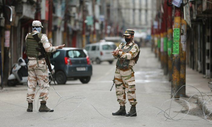 Security personnel stand guard during a nationawide lockdown in the wake of coronavirus pandemic. (PTI Photo)