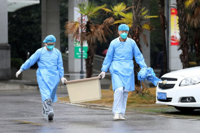 Medical staff carry a box as they walk at the Jinyintan hospital, where the patients with pneumonia caused by the new strain of coronavirus are being treated, in Wuhan, Hubei province, China January 10, 2020. Credit: Reuters photo