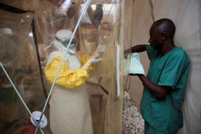 A health worker wearing Ebola protection gear enters the Biosecure Emergency Care Unit (CUBE) at the ALIMA (The Alliance for International Medical Action) Ebola treatment centre in Beni, in the Democratic Republic of Congo. (Reuters File Photo)