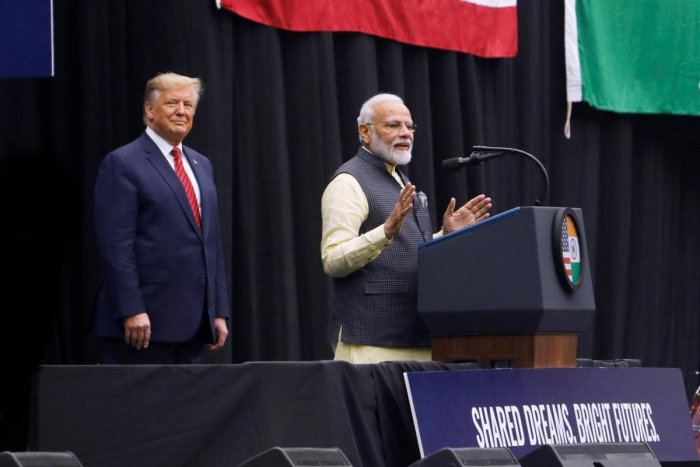 """U.S. President Donald Trump looks on as Indian Prime Minister Narendra Modi speaks during a """"Howdy, Modi"""" rally at NRG Stadium in Houston. (Reuters Photo)"""