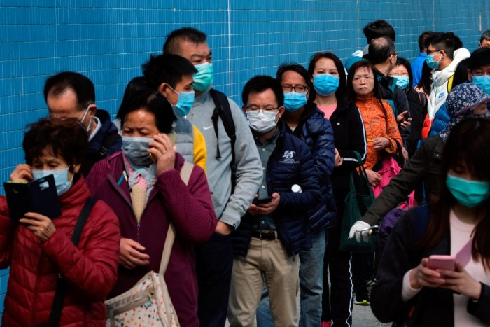 Customers queue to buy facial masks to prevent an outbreak of a new coronavirus, in Hong Kong, China January 28, 2020. (Reuters Photo)
