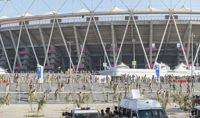 Police personnel keep vigil at Sardar Patel Stadium, commonly known as Motera Stadium, which will host 'Namaste Trump' event during US President Donald Trump's maiden visit to India, in Ahmedabad, Saturday, Feb. 22, 2020. (PTI Photo)