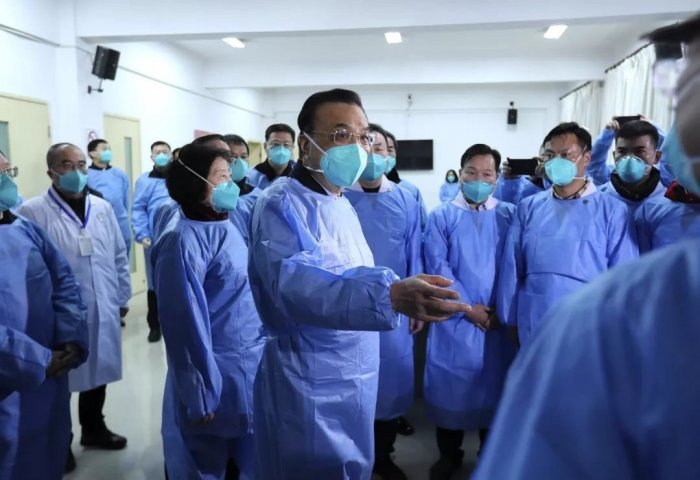 Li went to the city to inspect the ongoing efforts to contain the epidemic and spoke with patients and medical staff, China's government said in a statement. Credit: Twitter (@weiasecas)