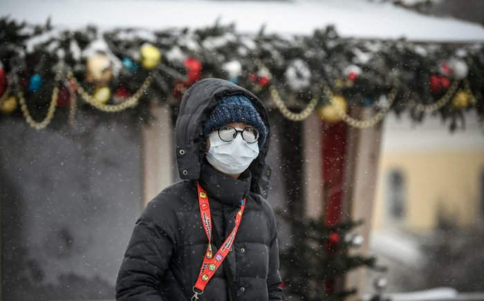 In this file photo taken on January 29, 2020 A tourist wearing a medical mask walks along a street in Moscow. AFP