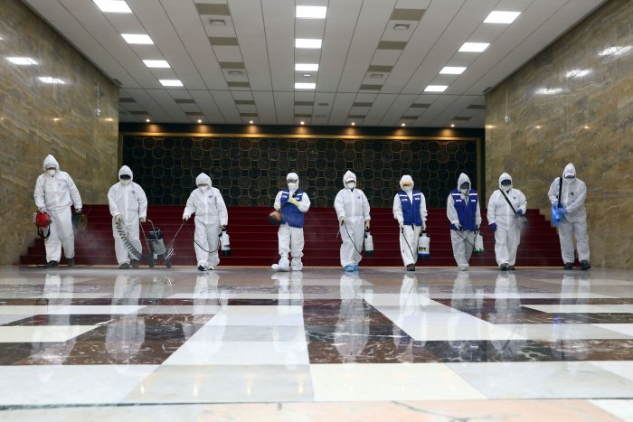 Employees from a disinfection service company sanitize the National Assembly in Seoul, South Korea. (Credit: Reuters Photo)