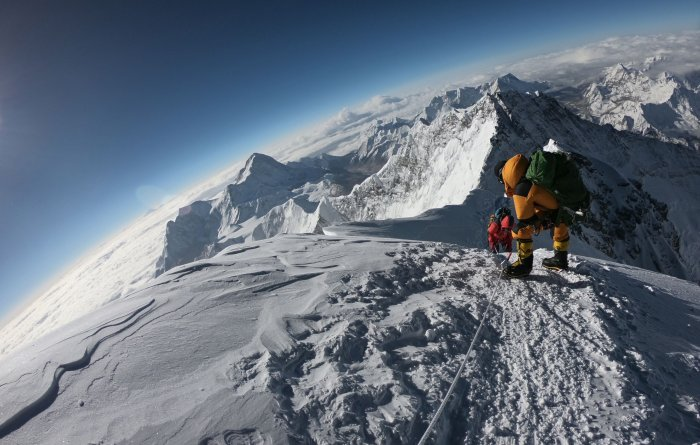 Mountaineers make their way to the summit of Mount Everest, as they ascend on the south face from Nepal. (AFP Photo)