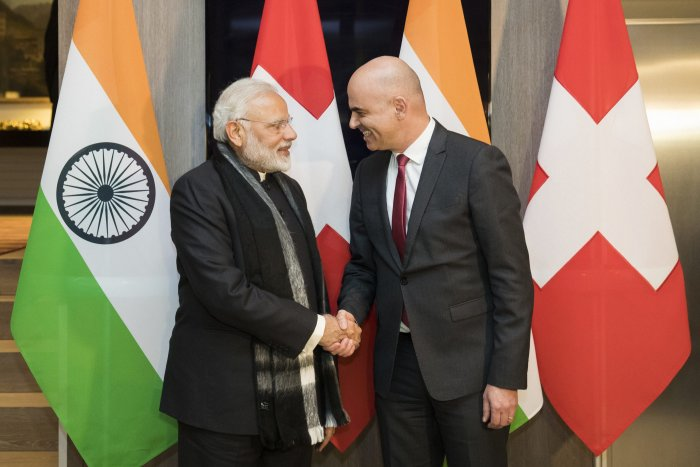 Swiss Federal President Alain Berset, right, and Indian Prime Minister Narendra Modi, shake hands prior to a meeting one day before the start of the 48th annual meeting of the World Economic Forum, WEF, in Davos, Switzerland. (AP Photo)