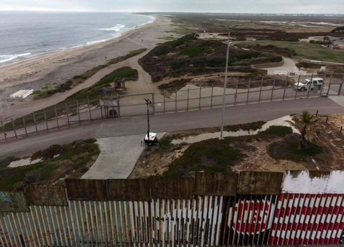 The federal Public Safety Department said on Thursday that the migrants recounted a long, complicated trip in a bid to reach the US border. Aerial view of the US-Mexico border fence in Playas de Tijuana, Baja California state, Mexico on June 10, 2019. Photo/AFP