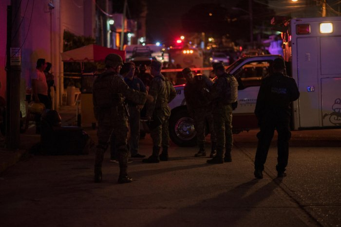 Soldiers gather near a crime scene following a deadly attack at a bar by unknown assailants in Coatzacoalcos. Reuters photo
