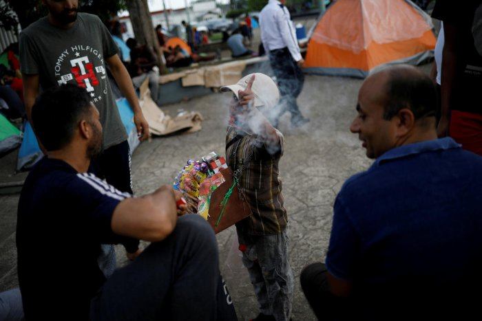 Migrants from India outside of Siglo XXI migration facility (Reuters Photo)