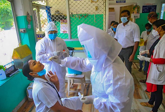 Staff members at a sealed hospital give samples for COVID-19 tests after a relative of a patient was detected positive for the new virus, at Krishnan Kovil village of Nagercoil in Kanyakumari district, Thursday, May 7, 2020. (PTI Photo)