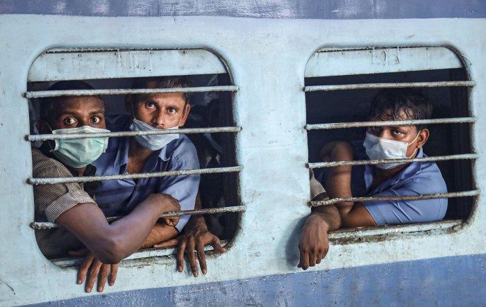 Passengers wearing masks in the wake of coronavirus (COVID-19) pandemic travel in a train, in Kozhikode. (PTI Photo)