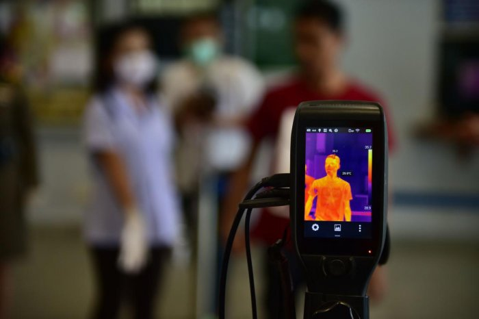 A thermal camera monitor shows the body temperatures of a man at the customs checkpoint in Sungai Kolok in southern Thailand's Narathiwat province on the Thailand-Malaysia border on March 15, 2020. Credit: AFP Photo