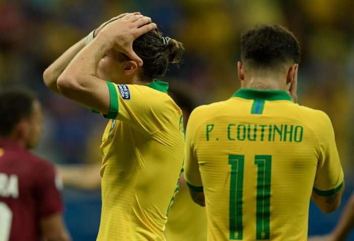Brazil's Filipe Luis (L) and Philippe Coutinho react during their Copa America football tournament group match against Venezuela at the Fonte Nova Arena in Salvador, Brazil, on June 18, 2019. (AFP)