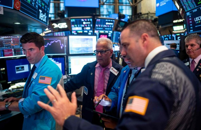 Traders work after the closing bell at the New York Stock Exchange (NYSE) on August 12, 2019 at Wall Street in New York City. - Wall Street stocks finished a bruising session sharply lower as worries about slowing growth and the protracted US-China trade