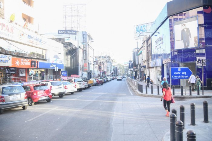 The usually crowded Brigade Road in Bengaluru wears a deserted look as people did not venture out following Covid-19 outbreak. DH PHOTO/ THEJAS G D