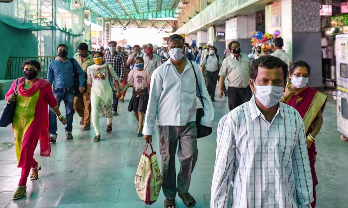 Passengers wearing masks in the wake of coronavirus pandemic, at Sealdah railway station in Kolkata, Saturday, March 21, 2020. (PTI Photo)