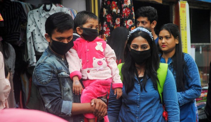 People wear masks as preventive measures in the wake of the novel coronavirus scare at Fancy Bazar market in Guwahati, ([PTI Photo)