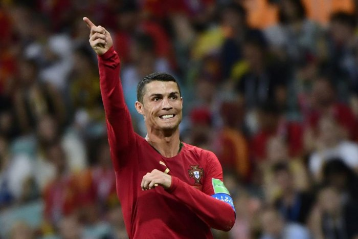 Cristiano Ronaldo scored a stunning hat-trick as Portugal snatched a 3-3 draw with Spain in a World Cup classic here Friday. AFP