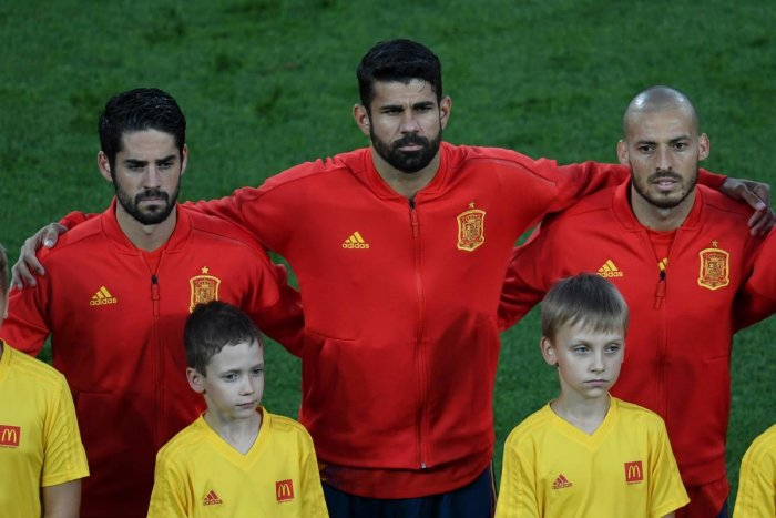 Spain's midfielder Isco, Spain's forward Diego Costa and Spain's forward David Silva listen to their national anthem before the Russia 2018 World Cup Group B football match between Spain and Morocco at the Kaliningrad Stadium in Kaliningrad on June 25, 20