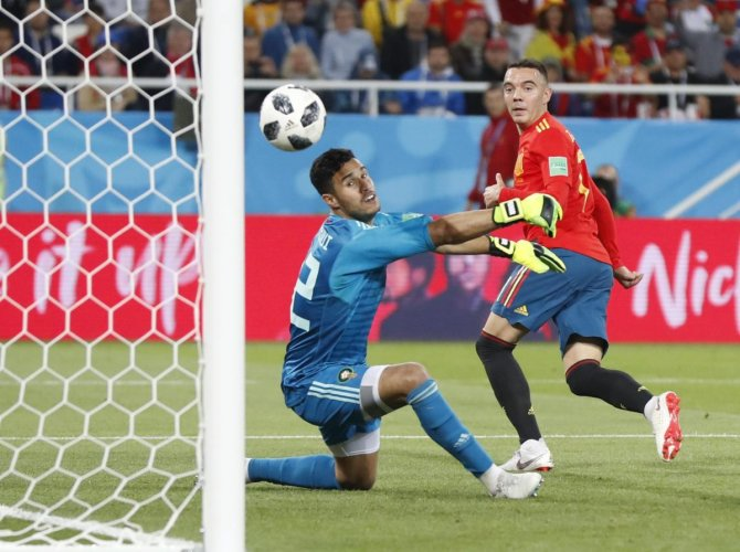 CLEVERLY DONE: Morocco goalkeeper Monir El Kajoui (left) watches in horror as Iago Aspas' back-heel flies into the net during the Group B clash against Spain on Monday. AP/PTI