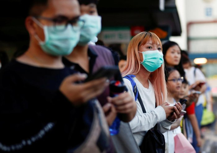 Commuters wait for a transport to leave the Woodlands Causeway across to Singapore from Johor, hours before Malaysia imposes a lockdown on travel due to the coronavirus outbreak. Credit: Reuters File Photo