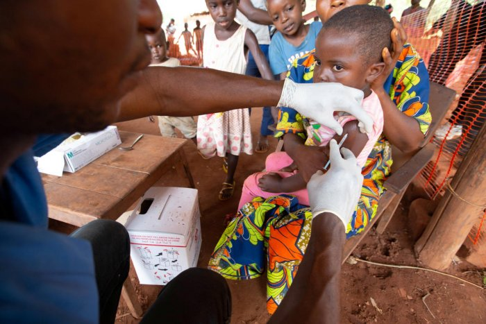 A child is given a measles vaccination during an emergency campaign run by Doctors Without Borders (MSF) in Likasa, Mongala province in northern Democratic Republic of Congo March 3, 2020. Credit: Reuters Photo