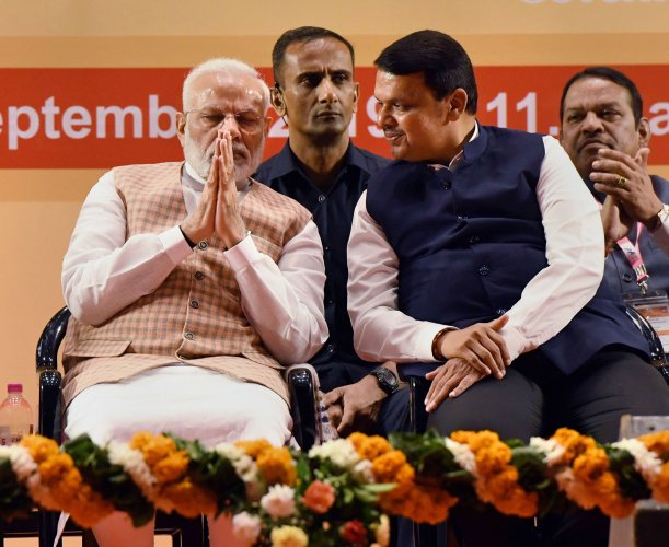 Prime Minister Narendra Modi and Maharashtra Chief Minister Devendra Fadnavis. (PTI Photo)