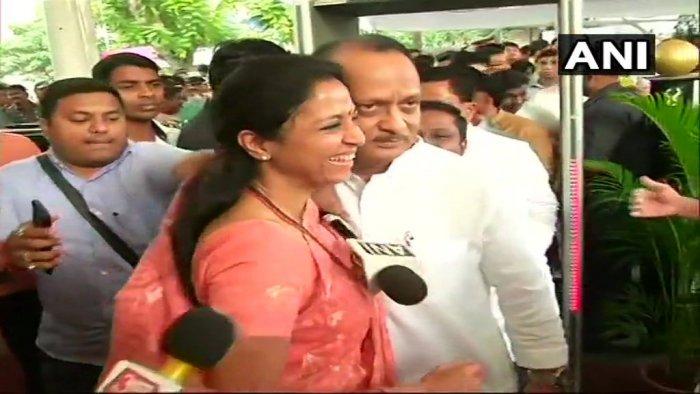 NCP leader Supriya Sule welcomed Ajit Pawar at Maharashtra Assembly.(Photo: ANI)
