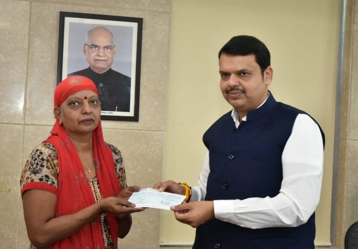 """""""CM Devendra Fadnavis' first signature of this tenure was done on a #CMReliefFund cheque, on reaching Mantralaya, which was handed over to Kusum Vengurlekar by CM,"""" the chief minister's office tweeted."""