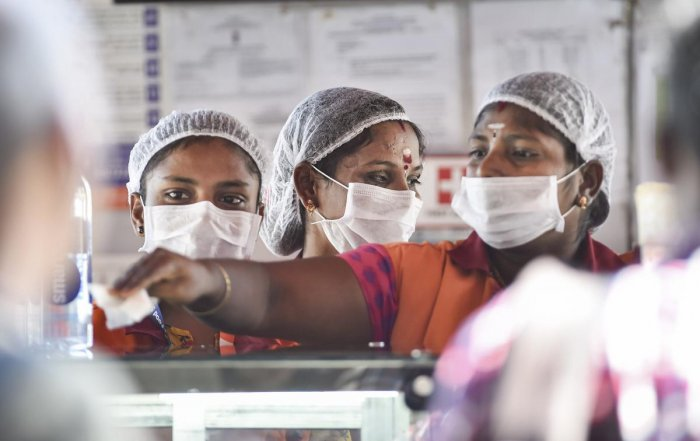 Workers wear masks to protect themselves in the wake of deadly coronavirus, at Chennai airport, Tuesday, March 17, 2020. (PTI Photo)