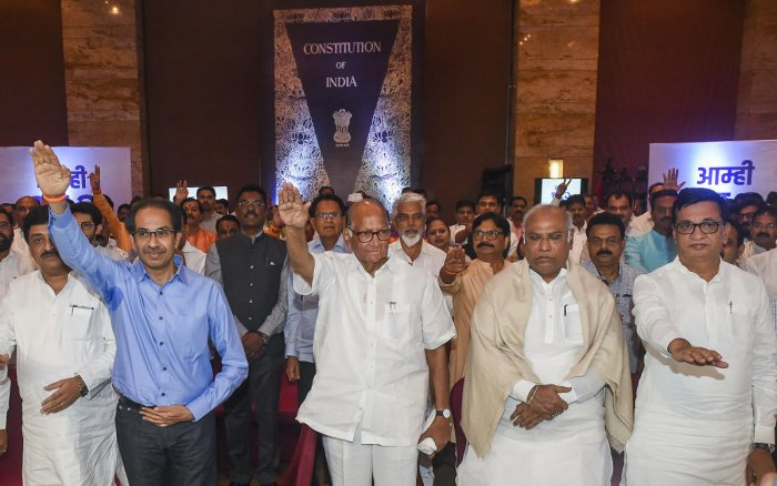 Congress leader Mallikarjun Kharge (second from right), NCP chief Sharad Pawar and Shiv Sena President Uddhav Thackeray at the show of strength in Mumbai on Monday. PTI