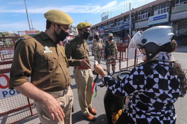 Police officials check ID cards of commuters after lockdown due to the coronavirus outbreak, in Jammu, Monday, March 23, 2020. (PTI Photo)
