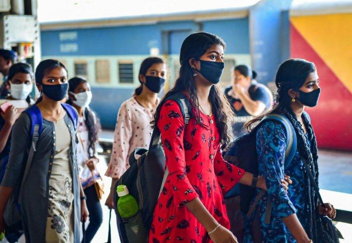 Passengers wearing masks in wake of coronavirus (COVID-19) pandemic walk inside Bengaluru City Railway Station, Monday, March 16, 2020. (PTI Photo)