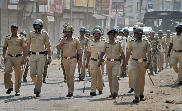 Police officials patrolling after Dalits called for Maharashtra Bandh as a protest over Bhima Koregaon violence, at Sangli in Maharashtra. (PTI Photo)