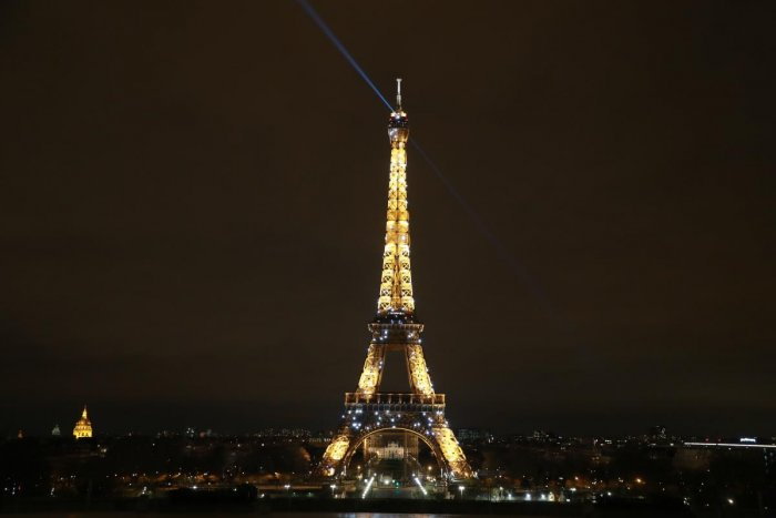 A picture taken in Paris on March on 17, 2020, shows the Eiffel Tower shining brightly every evening at 8 p.m. since March 20, 2020 to support hospital staff and other people involved in the fight against coronavirus. (AFP Photo)