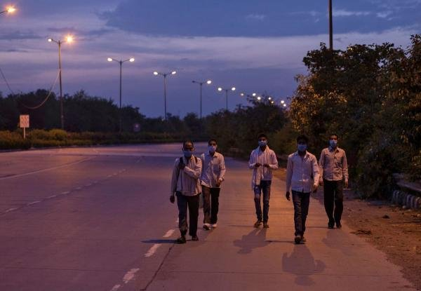Migrant workers walk along a road to return to their villages, during a 21-day nationwide lockdown to limit the spreading of coronavirus disease, in New Delhi. (Credit: Reuters Photo)