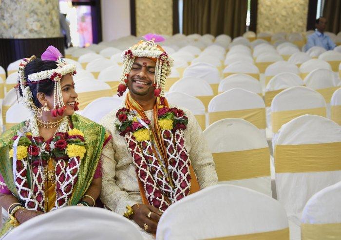 Ruchit Sane (groom) and Akshita Vaidya (bride) share a light moment during their wedding ceremony in Mumbai. (Credit: PTI Photo)