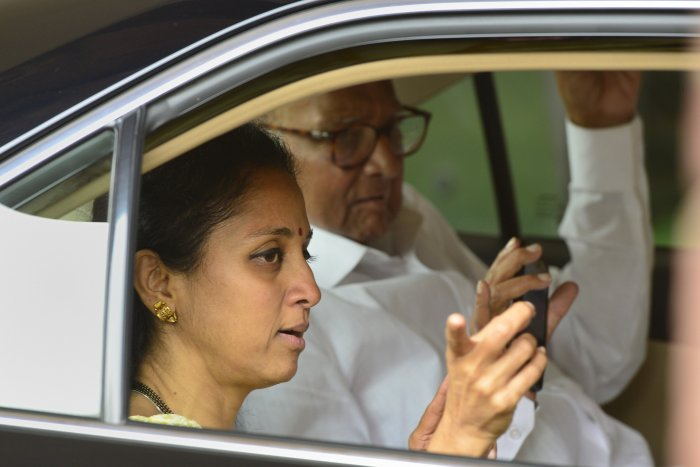 Nationalist Congress Party (NCP) Chief Sharad Pawar with daughter and MP Supriya Sule. (Credit: PTI)
