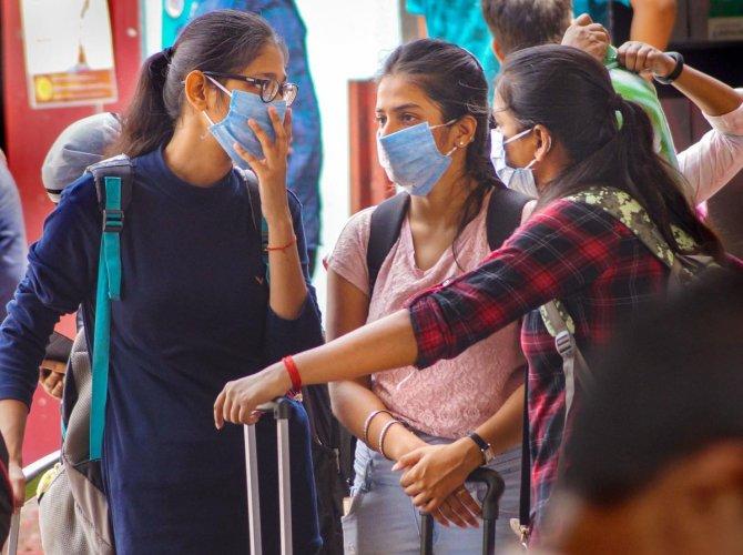 Passengers wear masks as a preventive measure against novel coronavirus (COVID-19) pandemic, at Bhubaneswar railway station, Tuesday, March 17, 2020. (PTI Photo)